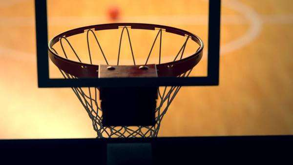 Panning camera over backboard basket on court Royalty-free stock video
