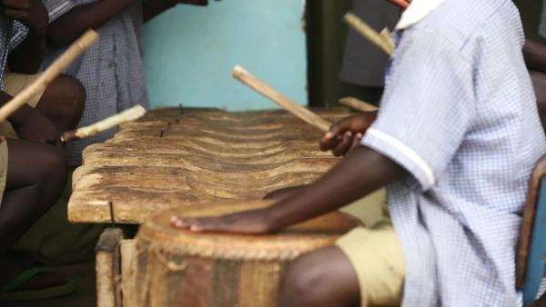 Close-up shot of people playing on percussion instruments Royalty-free stock video