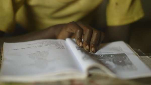 Close-up shot of Ethiopian child reading a book Royalty-free stock video