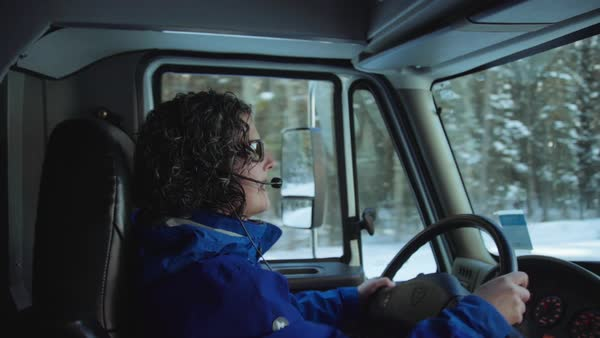 Medium shot of a woman driving a bus Royalty-free stock video