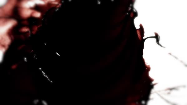 High-speed camera shot of a blood element splatter, isolated on a white  background stock footage