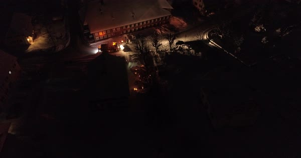 Aerial shot of a snow plow driving in a winter town Royalty-free stock video