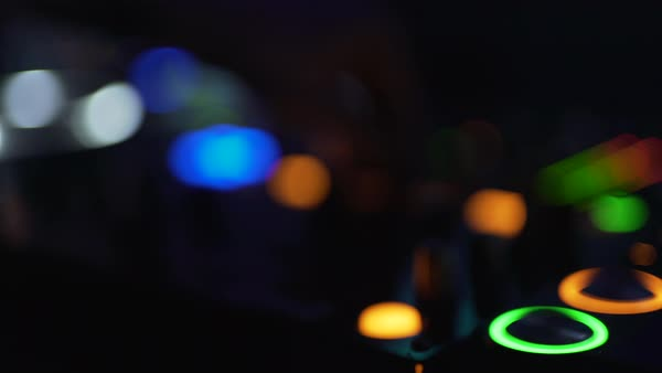 Hand-held shot of a disc jockey mixing music at a party Royalty-free stock video