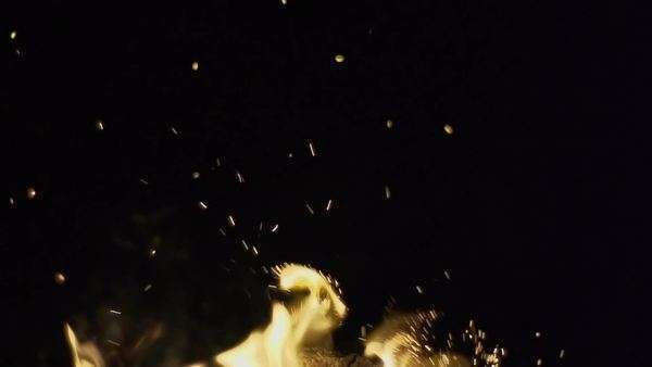 Slow motion detail of sparks coming out of fire at night Royalty-free stock video