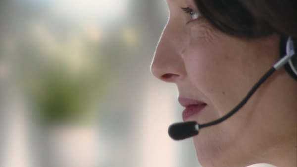Extreme close-up, Profile of businesswoman wearing headset Royalty-free stock video