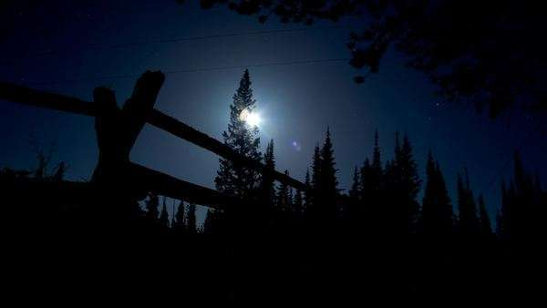 Night timelapse of the moon rising across a log fence Snowy Range, Wyoming Royalty-free stock video