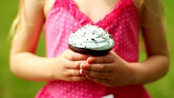 Little girl holding cupcake Royalty-free stock video