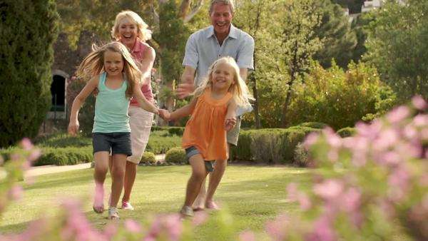 Grandparents and two granddaughters running to camera. Royalty-free stock video