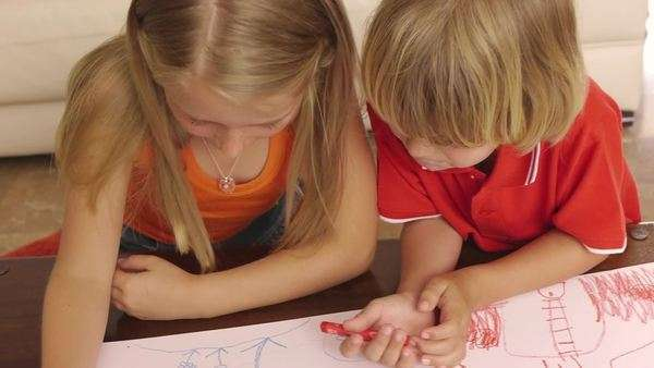 High angle shot of brother and sister coloring together. Royalty-free stock video