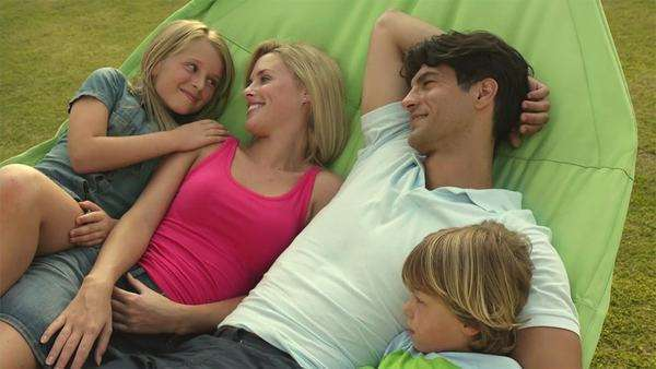Family in hammock in garden. Royalty-free stock video