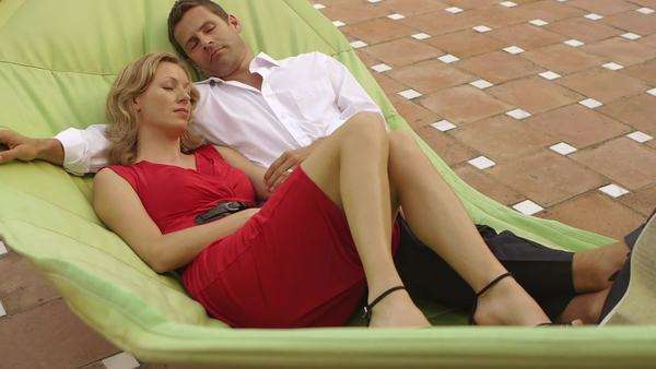 Crane shot of couple relaxing in hammock together. Royalty-free stock video