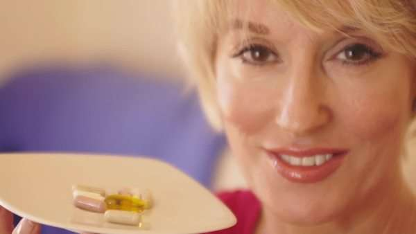 Close up of woman taking vitamin pill. Royalty-free stock video