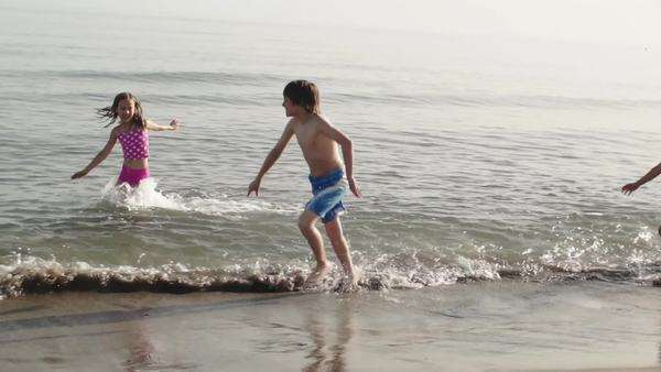 Five children playing in surf. Royalty-free stock video