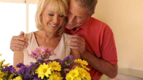 Senior couple indoors flower arranging. Royalty-free stock video