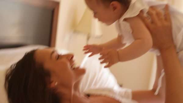 Mother and baby on bed Royalty-free stock video