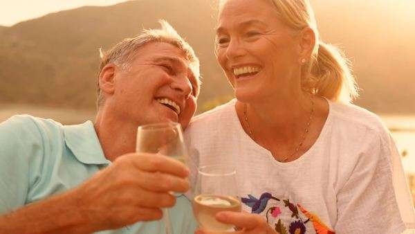 Mature couple sitting in countryside in sunset with wine Royalty-free stock video