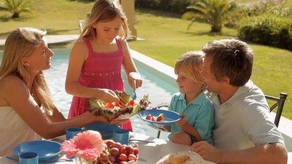 family having meal by garden pool Royalty-free stock video