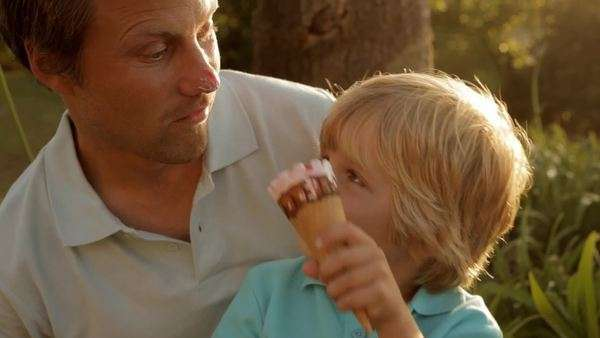 father and son playing with ice cream Royalty-free stock video