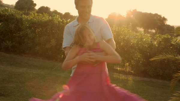 father and daughter twirling in sunset Royalty-free stock video