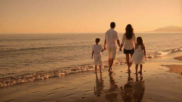 family standing on beach in sunset Royalty-free stock video