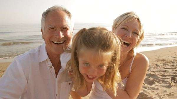 grandparents and granddaughter on beach Royalty-free stock video