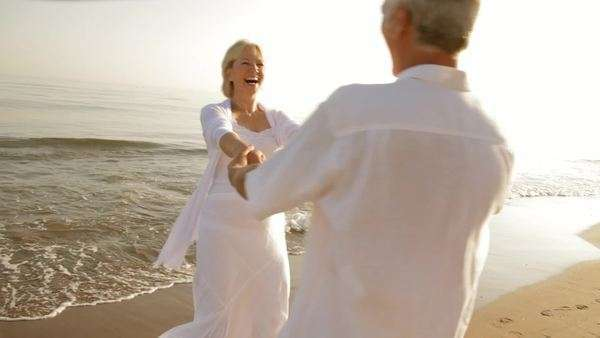 senior couple hugging and twirling on beach Royalty-free stock video