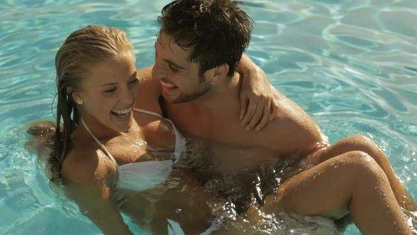 young couple playing and laughing in pool Royalty-free stock video