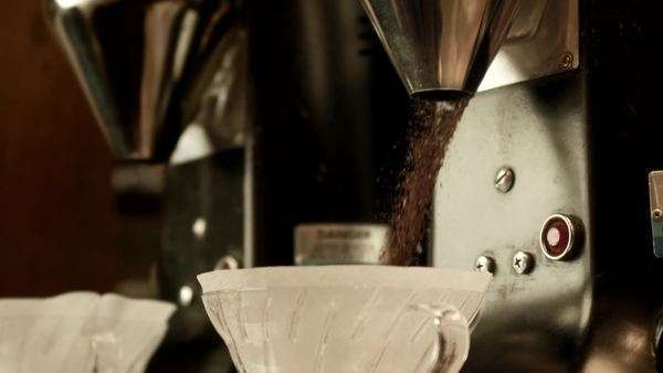 Ground coffee pouring into filters Royalty-free stock video