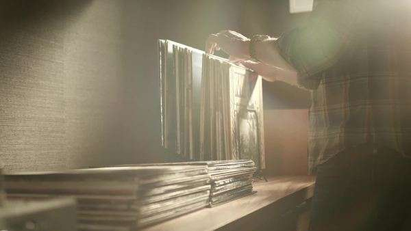 Man selecting vinyl record from a stack Royalty-free stock video