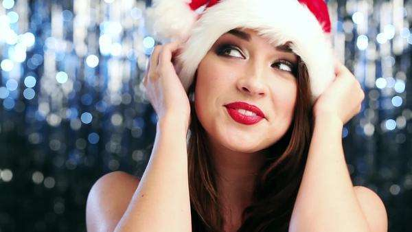 Woman wearing a santa hat posing for camera Royalty-free stock video