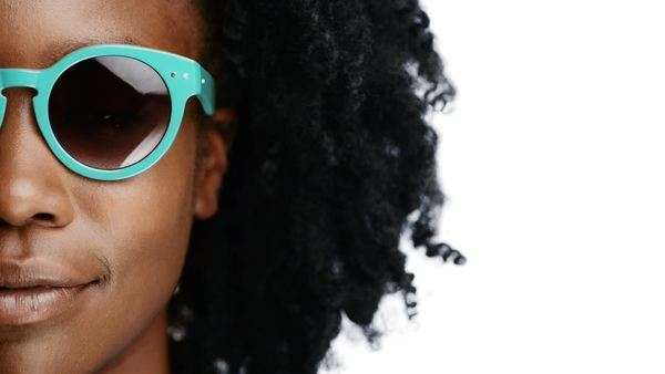 African Woman wearing sunglasses portrait close up half face character series isolated on pure white background Royalty-free stock video