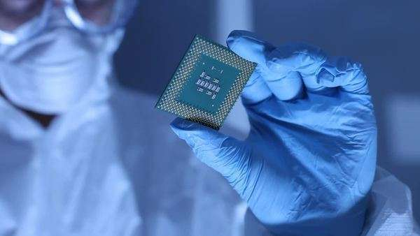 Man in clean room holds up computer cpu microchip Royalty-free stock video