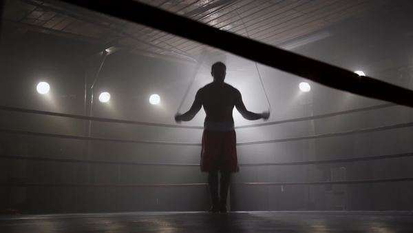 Boxer jumping rope in boxing ring Royalty-free stock video