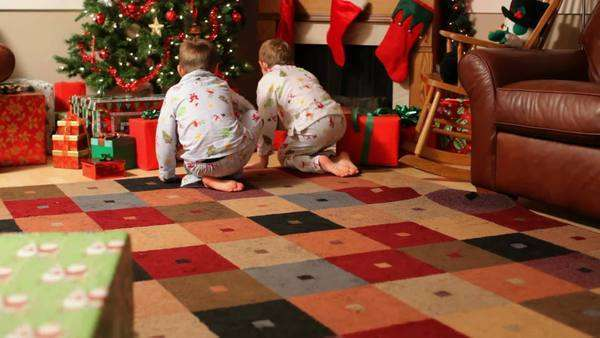 Two young boys run to gifts on Christmas morning Royalty-free stock video