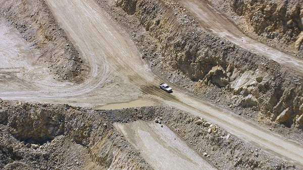 Aerial shot of truck driving through quarry Royalty-free stock video