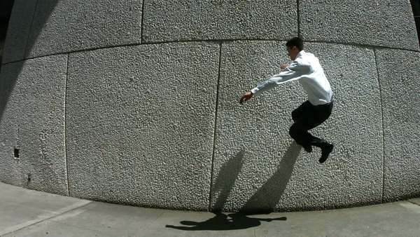 Business man jumps off wall, slow motion Royalty-free stock video