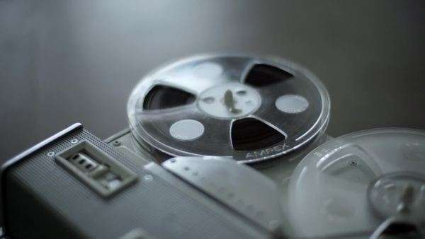 Tape reels spin on an old recording device Royalty-free stock video