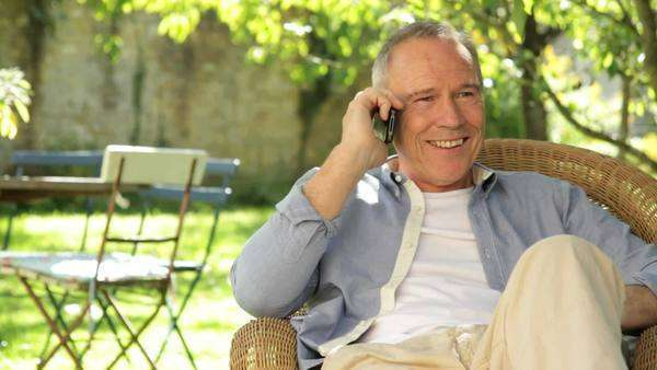 Senior male on phone talking in the garden Royalty-free stock video