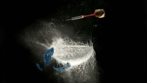Dart pops water balloon, slow motion Royalty-free stock video