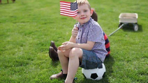 Young boy waving American flag Royalty-free stock video