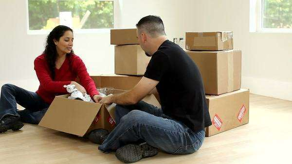 Couple unpacking boxes Royalty-free stock video