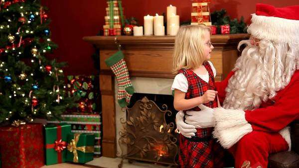 Santa Claus giving gift to young girl Royalty-free stock video