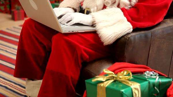 Santa Claus working on laptop computer Royalty-free stock video