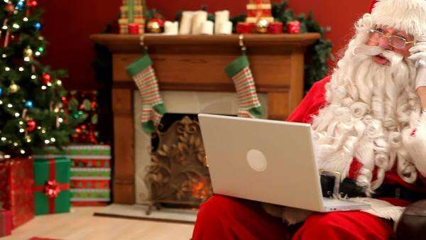 Santa Claus with laptop and cell phone Royalty-free stock video