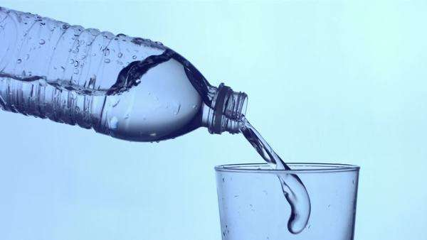Bottle of water pouring into a glass, slow motion Royalty-free stock video