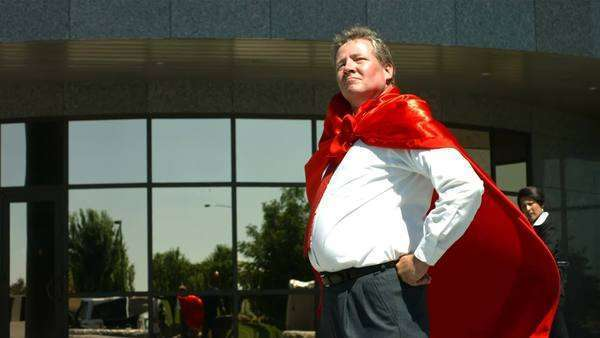 Businessman wearing superhero cape Royalty-free stock video
