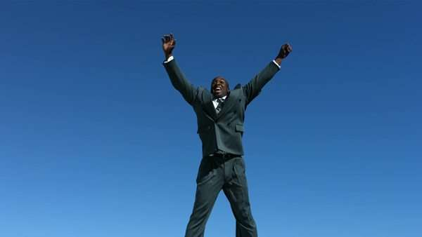 Businessman jumps into air celebrating, slow motion Royalty-free stock video