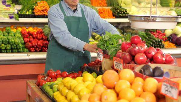 Portrait of produce man working at grocery store Royalty-free stock video
