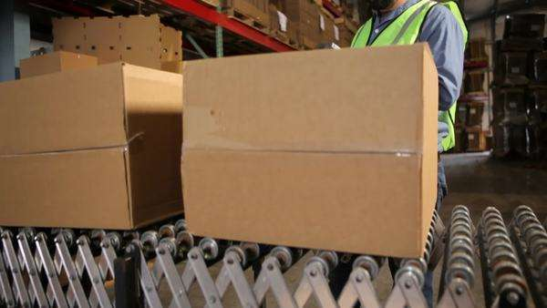 Man in shipping warehouse scans labels on boxes Royalty-free stock video