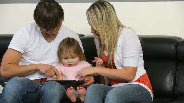 Family with young child playing with digital tablet Royalty-free stock video